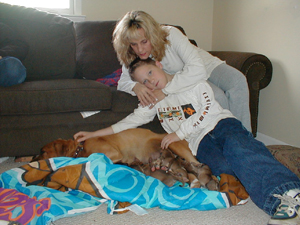 Betsy, Justin and Buddy with her pups