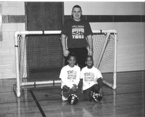 Learning the rules and skills of soccer is 7 year old Soccer League Player Angelique Wilson,  and Tiny Tot Indoor League Player Daniel Wilson, 5 years old with Program Director, Neil Condon.