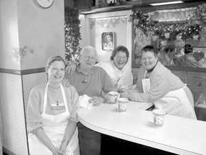 New Owners of The Waynedale Bakery (l to r) Christine Miller, Hal and Fran Clinger learning baking secrets from Bonnie Harris.