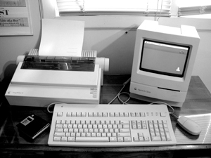 The Macintosh Classic with an Imagewriter II Printer.
