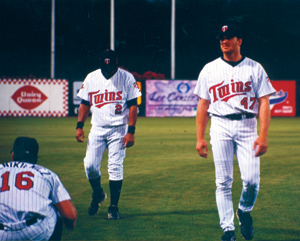 photo by Cindy Cornwell	 Florida Spring Training Twins warmup prior to game against St. Louis Cardinals – Ft. Myers, FL. Positions set in stone for the 2002 season: #16 Doug Mientkiewicz will be playing 1st base. Luis Rivas #2 will start at second base. #47 Corey Koskie third base.