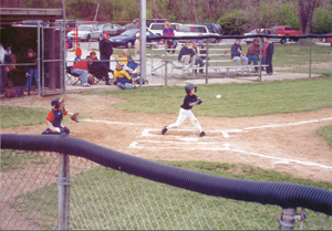 #5, Zach Ryan of East Chicago Pizza, takes a swing during the Prep game Thursday, April 30th, 2002.