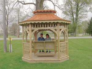 Expanding living to the outdoors…Steve and Gayla Gerber enjoying one of the many Amish-Crafted Gazebos. Steve's Landscaping also carries porch swings, playsets and planters.
