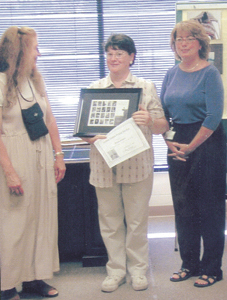 (l to r) Audrey Ushenko, IPFW Instructor; Sue Jensen, photo contest winner; and Lori Thomas, Customer Relations Coordinator for USPS.