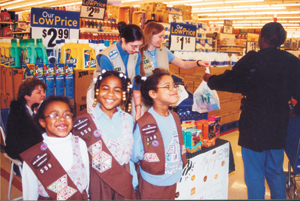 Brownie Girl Scout Troop #558 (Irwin Elem) (l-r) Sarah Roberts, Shakyra Robinson, and Korina Roberts learn business savvy during cookie sales at Kmart South from Cadette Girl Scout Troop #891 (Lake & Coliseum) Erin Lorenzen and Dana Leinhos.