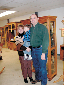 Stacy Clupper, 2-year old Jacob and her husband Scott recently opened Oak Comforts in  the Kingsland Furniture Store on Hwy 1.