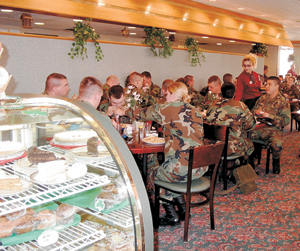 Unit 384 Officers prepare for final sendoff on Monday, March 17, 2003 during their working lunch at Azars Restaurant.