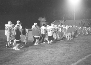 photo by rls #22 Jared Richards leads the Wayne Generals in congratulating the Elmhurst High School Trojans on their second win of the season. Elmhurst won the game 31 - 13 on Friday, September 13, 2003.