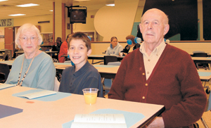 Miami Middle School student Manny Colburn enjoys breakfast with his grandparents Bill and Anna.