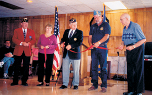 David Parrish American Legion Post 296 Celebrates Re-Opening After Flood 2003 (L-R) Tim Pape, Robert Ripley 4th District Commander, Karen Dumont President 296 Auxiliary, Larry Thiele Post 296 Commander, Denny Cunningham S.A.L. Post 296 Commander, and State Representive Ben GiaQuinta cut the ribbon on Saturday, October 18, 2003.