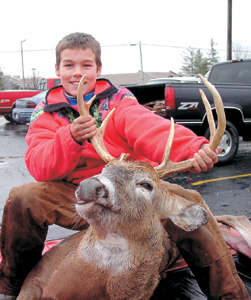 Proud Young Blood Tucker Smith shot his first deer with a muzzleloader. DNR Biologist Boszor estimated this deer to be about 2.5 years of age; based on the wear and number of teeth, and the size of antlers. Tucker's deer will be processed into brats and strips of steak. Tucker says the only kind of brats he likes are deer brats. Tucker is a student at Summit Middle School.
