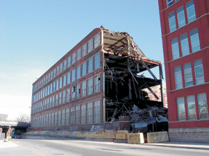 Looking northeast from Broadway, Dec 2, 2003, as Building 17 (built in 1911) goes by way of the wrecking ball.