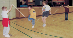 Maplewood Elementary students in Ms. Davis' gym class participating in the Jump Rope for Heart event held on Thursday, February 26, 2004. (l-r) Joey Brown, Jamie Orozco, Ms. Darla Davis, and Ashlyn Barger.