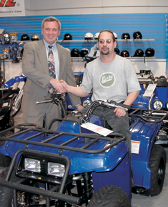 (L-R) are Jeff Krivacs, Waynedale branch manager of Tower Bank & Trust Company and Mark Derloshon at Fort Wayne Yamaha on Engle Road.