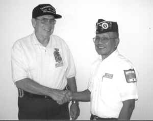 Pictured is medal recipient Paul Kiger on the left, being congratulated by Korean War Veteran Quiet Warrior Chapter President Marcos Botas.  Mr. Kiger served in Korea as a medic in the Twenty-fifth Infantry Division during 1958 and 1959.