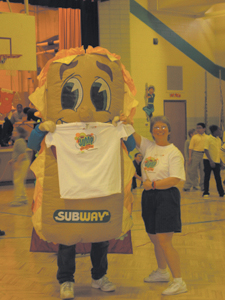 "Ms. Darla Davis, Maplewood Elementary's Jump Rope for Heart organizer, and the ""Subway Man"" gave away t-shirt's to participants jumping rope on Friday, February 15, 2005."