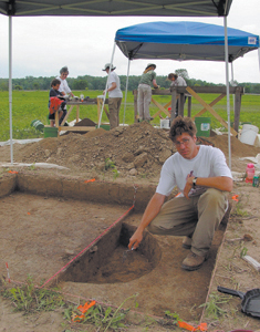 Assistant Director, Andrew White, IPFW Archaeological Survey, directs the excavation of sediments around an ancient fire pit. The Survey is committed to the dissemination of archaeological information and public involvement in Midwestern archaeology. They assist museums, local historical societies, and other groups in the investigation, documentation and interpretation of cultural resources.