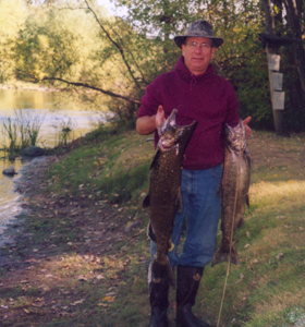 Tim Madru pulls these two king salmon out of the Muskegon River on Saturday, October 8, 2005.