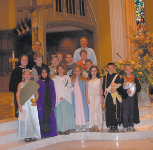 photo by Cindy Cornwell  Fourth-grade students (dressed as their favorite saint), Father Joe Rulli and Principal Michael Briggs from St. Therese gathered in The Cathedral of the Immaculate Conception in Fort Wayne along with more than 600 students on Monday, October 31 for the All Saints Day Mass.