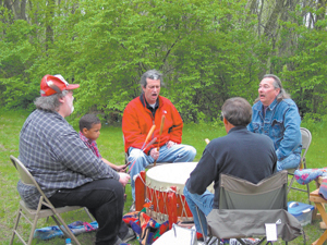 The Painted Turtle Drum & Singers presented traditional drumming songs on Saturday, May 5, 2007 opening a new season of programs at the Chief Richardville House.  (Clockwise) Red jacket George Strack, Jay Hartleroad, Gary Shoemaker, George Marks, Chase Conrad.
