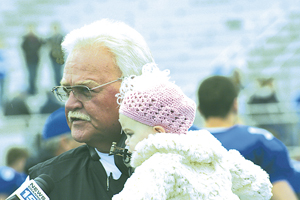 Coach Donley with his granddaughter Elizabeth during a home game interview.