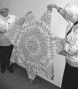 DAR member Linda Hoffman and Regent Joan Stripe admire the unfinished star piece.