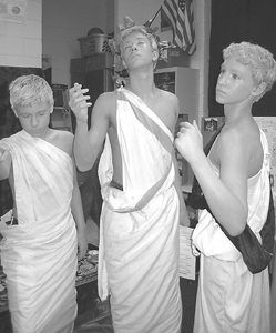 Eighth graders Matthew Paris, Noah Johnson and Alex Maldeney looking remarkably like Greek statues.
