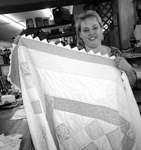 Celeste Saunier and her newly restored quilt border.