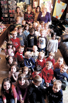 St. Joe-St. Elizabeth preschool students at Fabric and Friends Shop. In the back row are shop owners Deb and Stacey Roehm, Preschool Teacher Sharen Gall and Preschool Aide Lanette Gallagher.