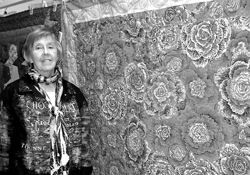 "Long-time Harlan resident Shirley Spindler and her ""Chintz"" quilt made of Kaffe Fassett fabrics."