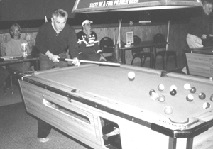 Pool Shark-Larry Elam demonstrating the art of the break shot at Mickey & Billy's, Southtown. (Keep the ball on the table Larry.)