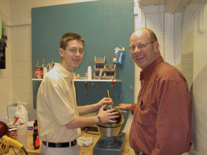 Collin Kerschner receiving some great tips from Carrol Coach Dave Kerschner in the Pro-shop at Village Bowl-Waynedale.