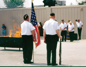 photo by Cindy Cornwell A ceremony to dispose of unservable flags was held on Saturday, August 3rd at the American Legion Post #241, 7605 Bluffton Road, Waynedale.