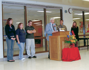 (L to R) Students from Don Goss' Art Classes, Anna Townsend, Amy Blough, Keven McClain, 'E' Award Recipient Don Goss, 2001 Recipient Mathematics Teacher Matthew Smith, and 'E' Project Manager Dolly Bauman.