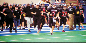 Bishop Luers 2A State Champions: 1985, 1989, 1992, 1999, 2001 and 2002 take the field at the RCA Dome, Indianapolis.
