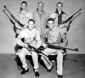 1956 Elmhurst High School Rifle Team placed first in the nation (non-military scholastic team).  Members were (l to r): Ron Reed (187), Coach Ray Reed, Linda Sheddick (191), Jim Hitzeman, and (189) Pete Eckrich (185).