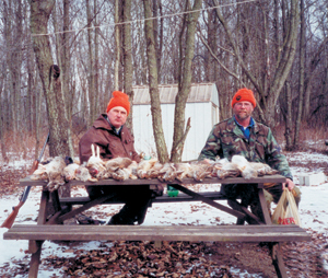 """It was the best day of rabbit hunting since '69. """"It's not about the killing,"""" said Mike Pine, """"it's about the male bonding on a cold January afternoon in Whitley County."""" With their limit of rabbits (l-r) Mike Pine-Columbia City and Pat Pine-Markle. Pat said he enjoyed the part when their mom, Shirley Pine cooked the rabbits for dinner."""