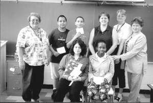 (L-R) Principal Miss Mary Schreiber, Julian Buitrage, Kyle Bolton, History teacher Mrs. Louise Schultheis, Teacher Miss Janet Alles and Helen Thiele. Seated, Alicia R. Lopez and Erica Woodard.