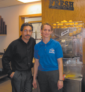 photo by Cindy Cornwell Spyro and Jean Giatras continue their families work at Spyro's Pancake House on Bluffton Road.  Ask them for a glass of their fresh squeezed orange juice-it's the best!