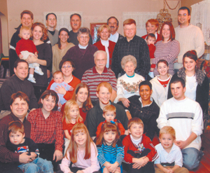 Joyful Tradition for 34 years. Dad and Mom, Russ and Virginia Deam (middle), daughters Sandy and Cathy standing behind their dad, with all the kids, grandkids, and great grandkids celebrating Christmas 2004.