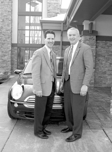 MarkleBank officially opened its new banking center on January 31, 2005. Grand opening events included winning a year's lease on this 2005 Mini Cooper photographed with (l-r) Keith Miller, Vice-President and Branch Manager and Travis Holdman, President and CEO.
