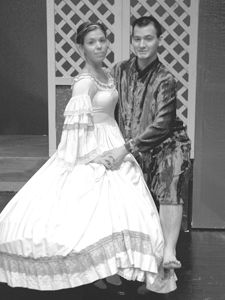 """Allie Townsend as Anna and Aaron Mann as the King dance to """"Shall We Dance"""" in the musical The King and I presented by Elmhurst High School."""