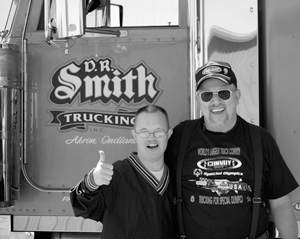 Trucks as far as the eye can see...participants in the World's Largest Truck Convoy take to the road to raise money for Special Olympics. (l-r) Shane Roell, Special Olympics athlete and Bob Raypholtz, co-chair of the 2004 Fort Wayne leg of the convoy.
