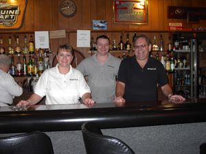 photo by Cindy Cornwell At the Waynewood Inn ready to serve you are: (l to r) Waitress Darcy Dettmer, and co-owners Chris Saine and Ed Scherschel. In the foreground, Lynn, a waitress has been with Waynewood for 19 years. As has Millie-19 years and Fran for 12 years. (not available for photo).