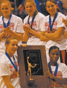 Photo by Joni Kuhn Lady Knights Recieve State Trophy L-R Megan Padro, Vinnie Dawson, Kierra Burnett, Melanie Huhn, Sarah Freiburger and Monica Lomuller