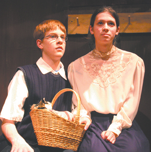 Peter, played by Paul Berghoff, and Anne, played by Becca Coffelt, welcome Mouchi, the cat, to their hiding place. The Diary of Anne Frank opens at Elmhurst High School on Thursday, December 7, 2006 at 7:30pm. Tickets available at the door.
