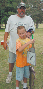 Connor Polka and his father, Jim, display the 3 5/8 pound catfish they caught to capture third place at the Wayne Township Trustee's Office Fishing Derby at the Lake at Concordia Theological Seminary. The Polkas, who reside in the Waynedale area, received a $25 gift card from Dick's Sporting Goods for their catch.