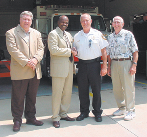 (L-R) Township Supervisor Rodney Scott, Trustee Stevenson, Chief Patnoude and Fire District Board President Ellis McFadden