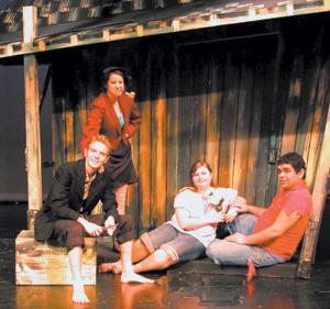 In Elmhurst's production Li'l Abner, Peter Schnellenberger plays Pappy Yokum, Sarah Smith plays Mammy Yokum, Lauren Marlow plays Daisy Mae, and Jose Serrato plays Li'l Abner Yokum.