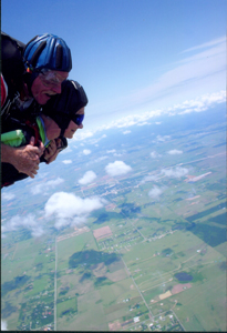 Virginia Badger and her instructor, Jim Culhain freefall through the skies over Houston.  At 6,000 feet the chute is deployed for a 6 minute ride back to earth.